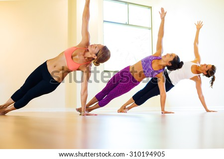 Group of Young People Relaxing Practicing Yoga, Healthy Lifestyle.  - stock photo