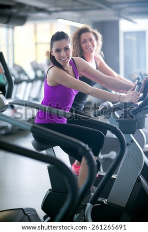 group of young people running on treadmills in modern sport  gym - stock photo