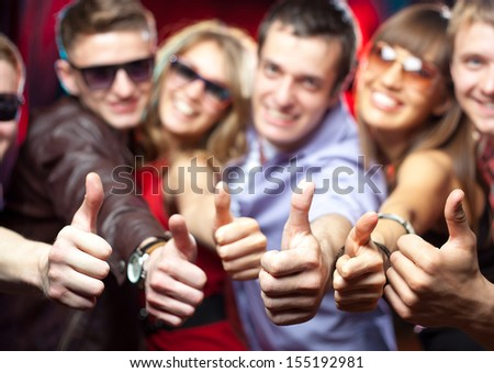 group of young people singing shows gesture OK at a party - stock photo