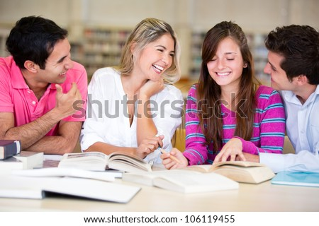 Group of young people studying at the library - stock photo