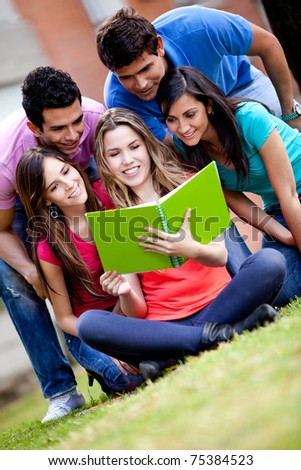 Group of young people studying outdoors - stock photo