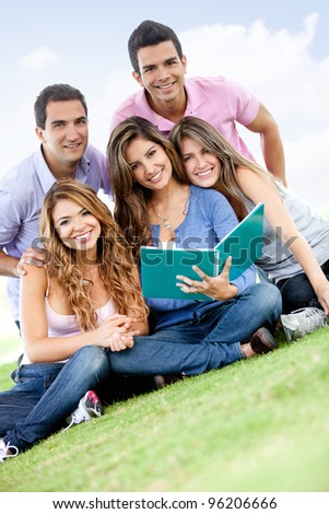 Group of young people studying outdoors and smiling
