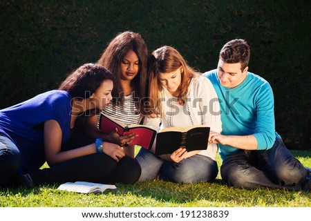 Group of Young people Studying the Bible together  - stock photo