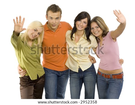 Group of young people. They're standing and looking at the camera. Two women are waving to the camera. Isolated on white in studio.