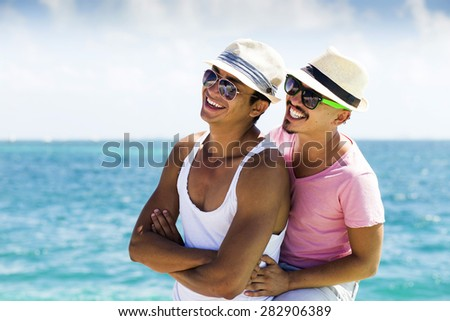 Group of young people traveling in latin-america. Isla Mujeres, Mexico. - stock photo