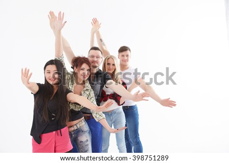 group of young people waving their hands