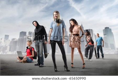 Group of young people with cityscape on the background - stock photo