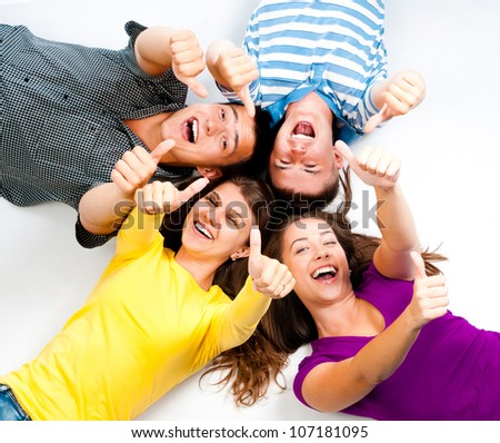 group of young people with thumbs up in a white background - stock photo