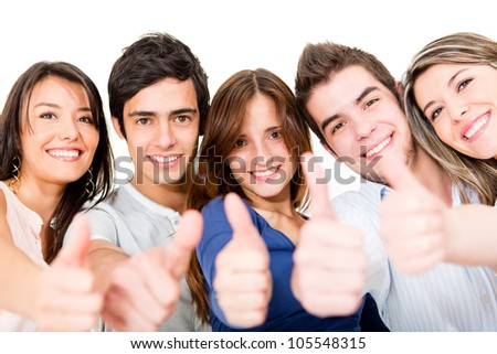 Group of young people with thumbs up - isolated over a white background - stock photo