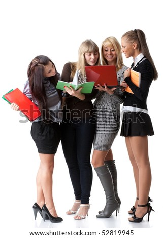 Group of young  people with writing-books on a white background. Students. - stock photo