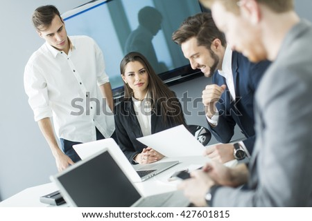 Group of young people working in the modern office - stock photo