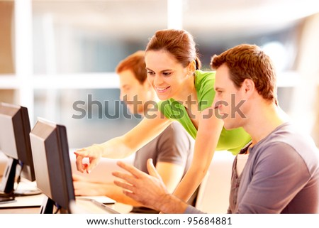 Group of young people working on computer - stock photo