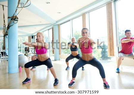 group of young people working out in a fitness gym - stock photo
