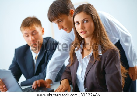 Group of young people working together - stock photo