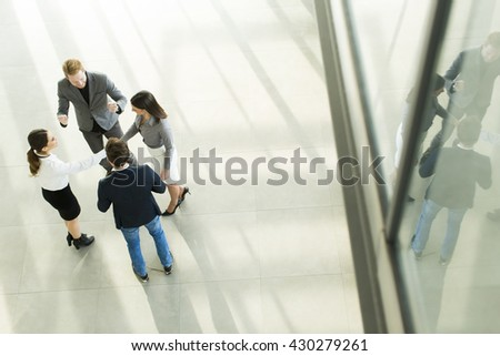 Group of young peopple in the modern office, viewed from above - stock photo