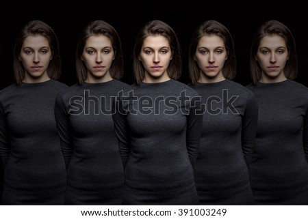 Group of young pretty women clones standing in a row