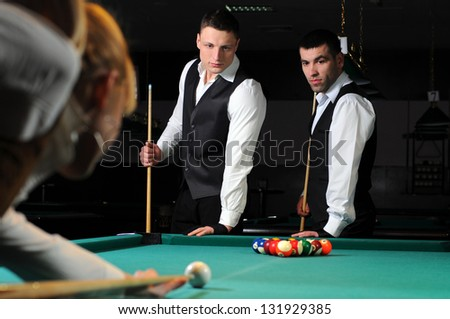 Group of young professionals, playing snooker - stock photo
