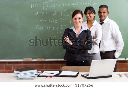 group of young school teachers in classroom - stock photo