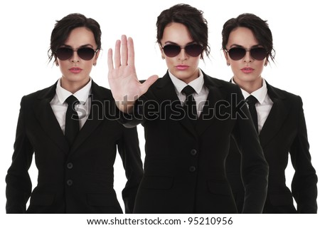 Group of young secret service agents or police officers isolated over white background - stock photo