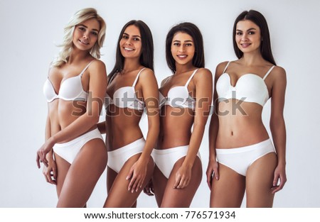 Group Of Young Sexy Multiracial Women In White Lingerie Are Posing On White Background Attractive