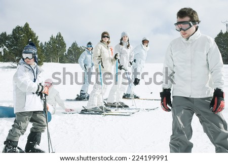 Group of young skiers standing on snow - stock photo