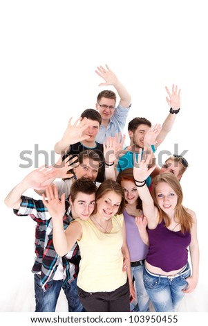 Group of young smiling friends waving their arms on white background - stock photo