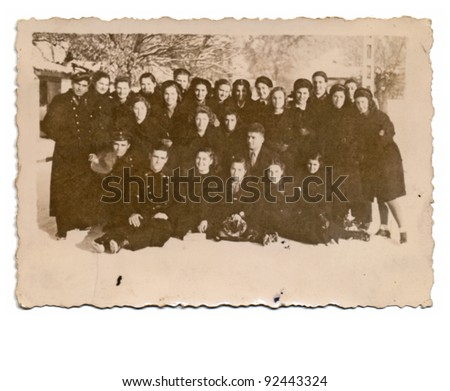group of young soldiers - boys and girls - vintage photo scan - about 1950 - stock photo