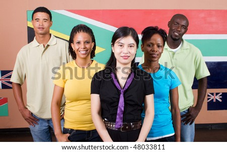 group of young South African people standing in front of South Africa flag, 2010 FIFA world cup concept - stock photo