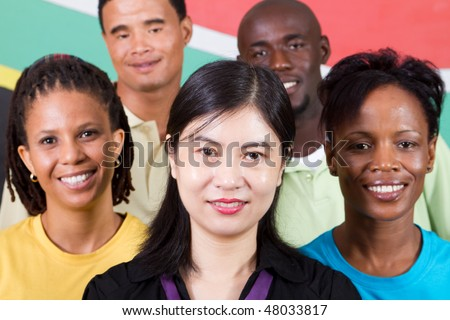 group of young South African people standing in front of South Africa flag, 2010 FIFA world cup concept