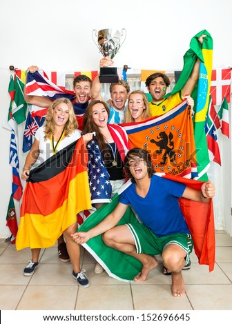 Group of young sports fans from various nations all over the world, celebrating and cheering together - stock photo