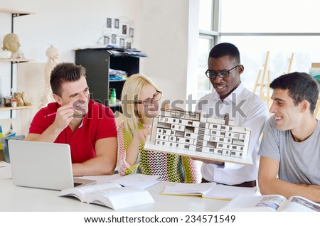 group of young students, black, white and girls earn 3D projects in the classroom - stock photo