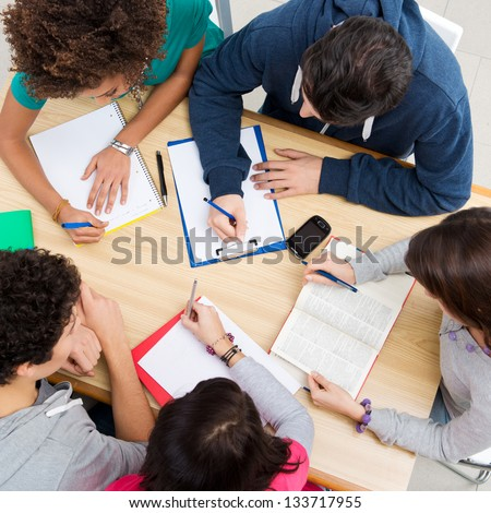 Group of young students studying together at college, high view angle - stock photo