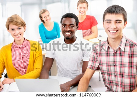 Group of young students studying together in a college - stock photo