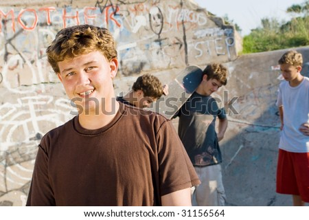 group of young teen boys together with skateboard on playground - stock photo