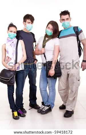 group of young teenagers with masks for protection