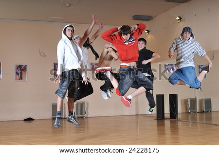 group of young teens jump in air together - stock photo