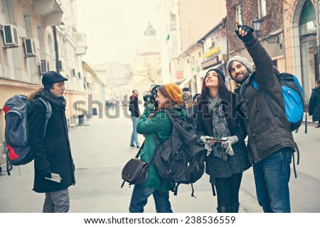 Group Of Young Tourists Sightseeing City - stock photo