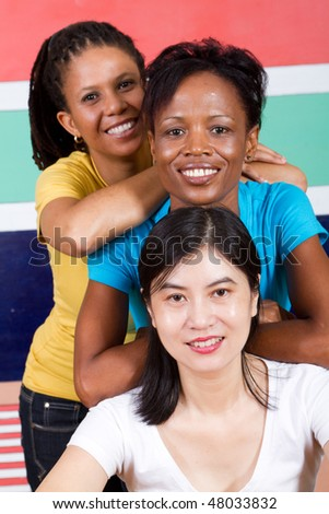 group of young woman in front of south african flag - stock photo