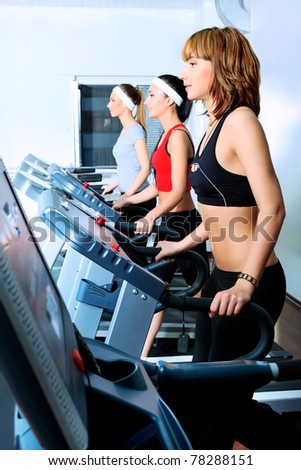 Group of young woman in the gym centre. - stock photo