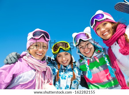 Group of young woman on ski holiday in mountains  - stock photo
