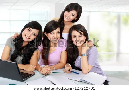 group of young woman studying together with friends - stock photo