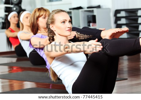 Group of young women in the gym centre. - stock photo