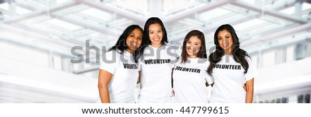 Group of young women who are volunteering for a project - stock photo