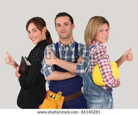 Group of young workers on white background