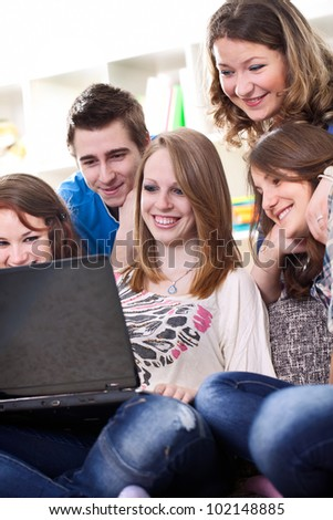 group of youth teens teenagers or college students with laptop computer - stock photo