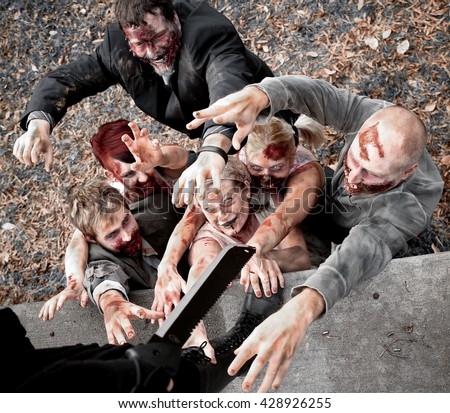 Group of Zombies Attacking - stock photo