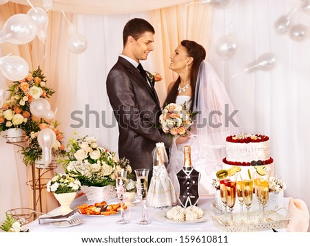 Group people at wedding table and balloon. Focus on the cake. - stock photo