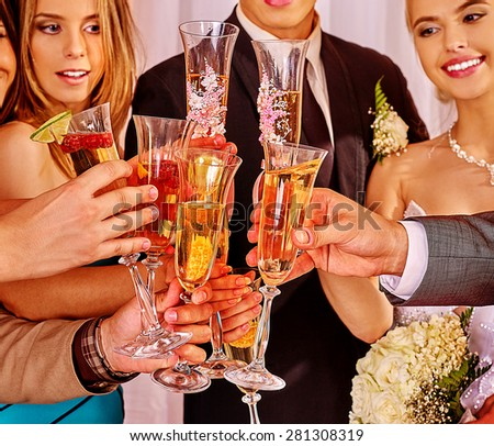 Group people at wedding table drinking champagne. - stock photo