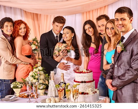 Group people at wedding table with cake. - stock photo