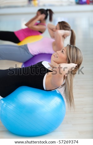 group people in a pilates class at the gym - stock photo